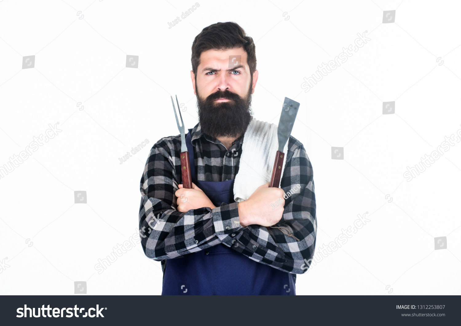 Roasting and grilling food. Man hold cooking utensils barbecue. Tools for roasting meat outdoors. Picnic and barbecue. Cooking meat in park. Masculine hobby. Bearded hipster wear apron for barbecue. #1312253807