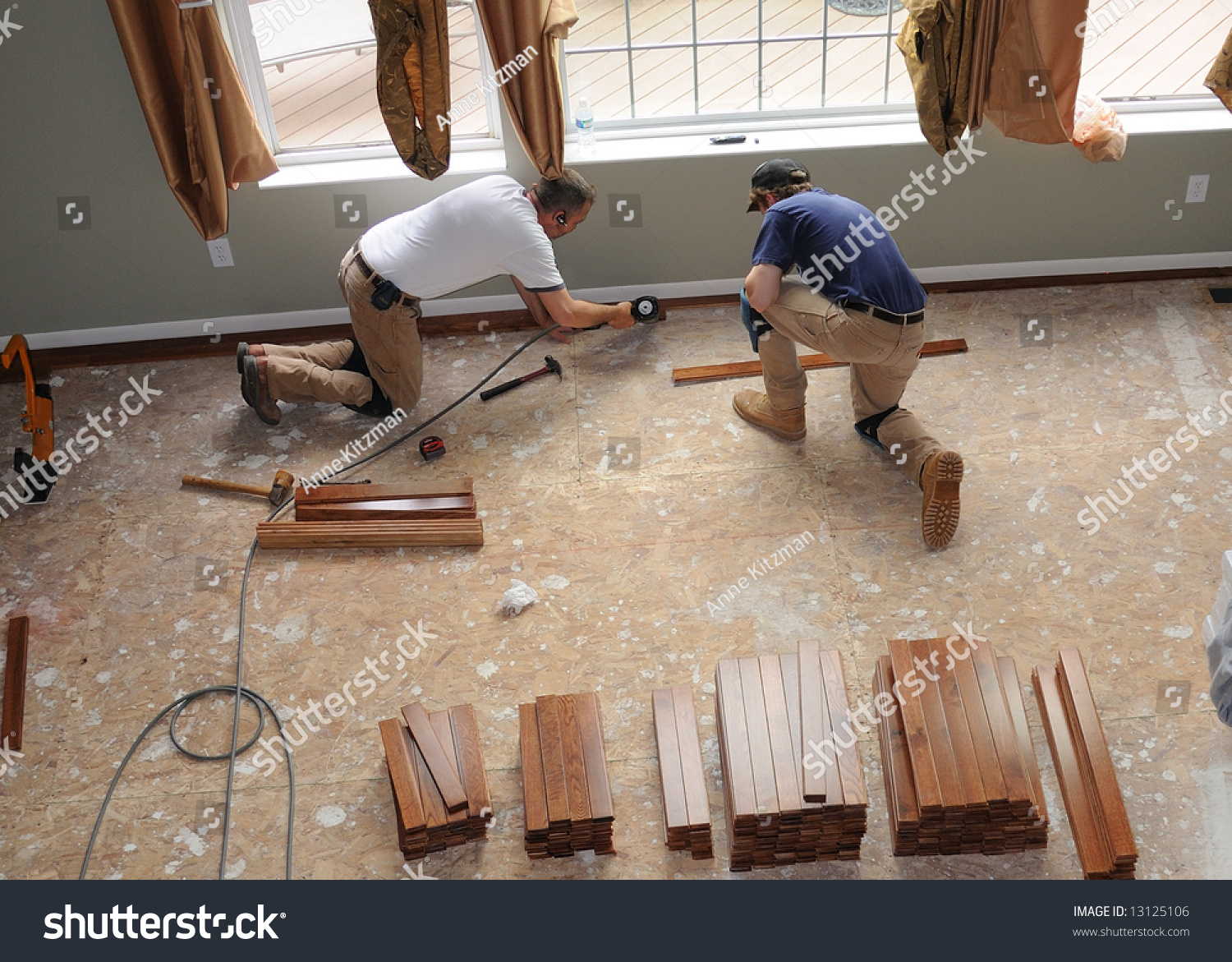 Hardwood Floor Installation Construction Workers Install Stock Photo How To Lay A Over Oriented Strand Board In