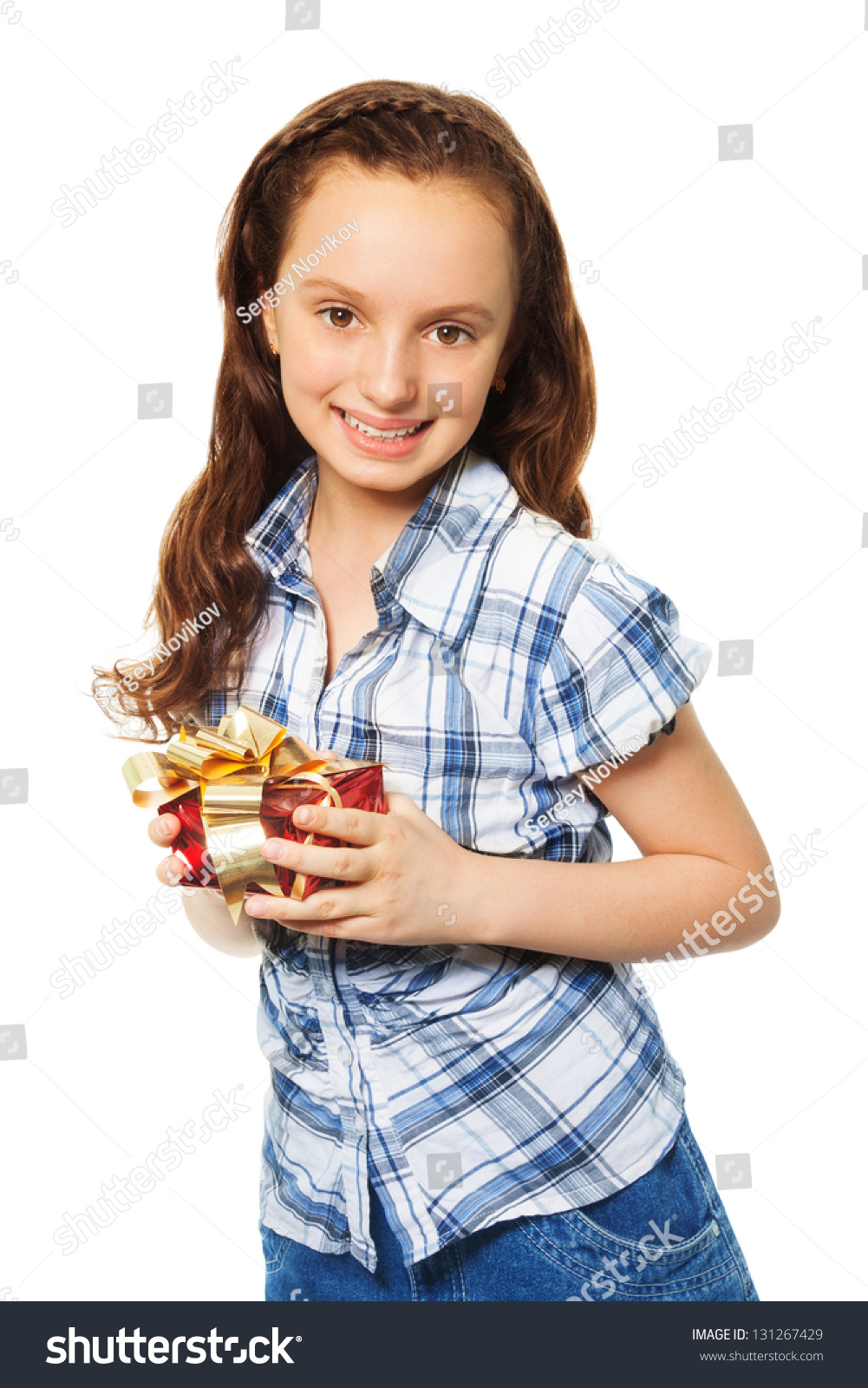 Happy Teen By Crumbling Wall Stock Image: Happy Teen Caucasian Girl Holding Small Red Present Box