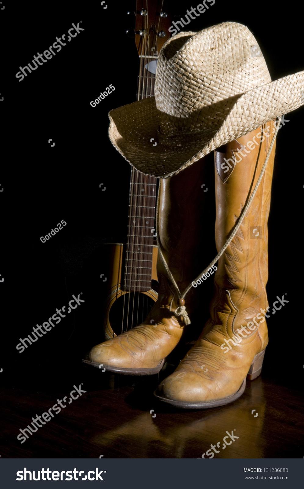 spotlight on country music symbols cowboy stock photo