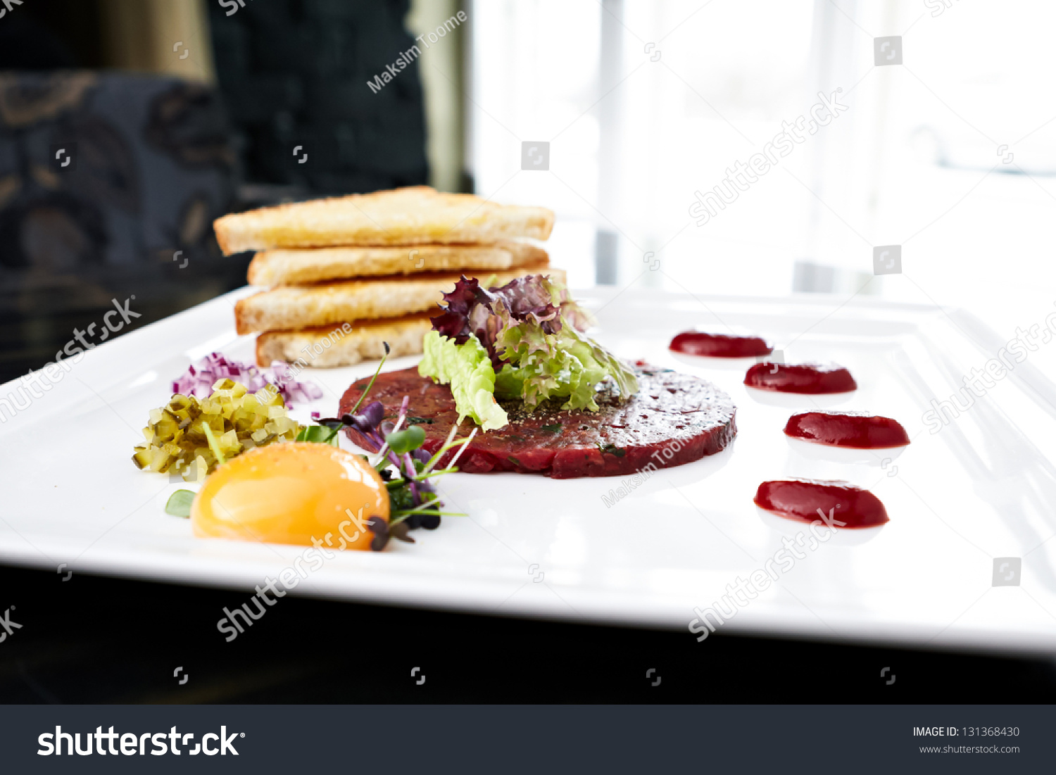 Classic Steak Tartare With Raw Egg And Croutons. Stock Photo 131368430 ...