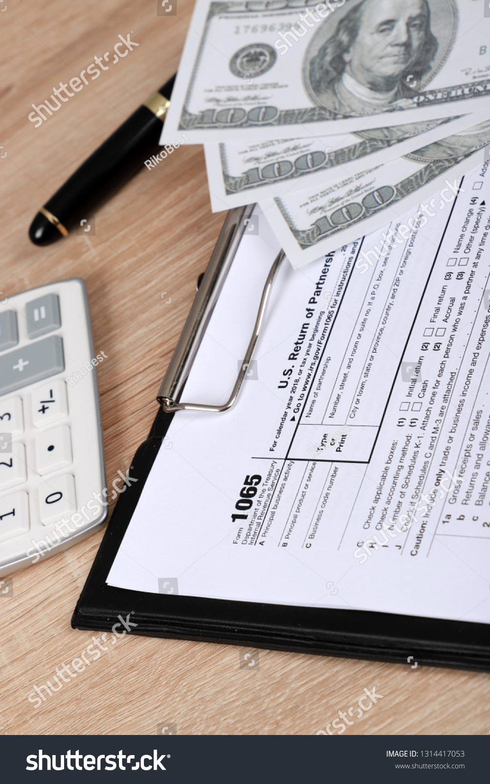 1065 Tax Form Lies Near Hundred Stock Photo (Edit Now) 1314417053