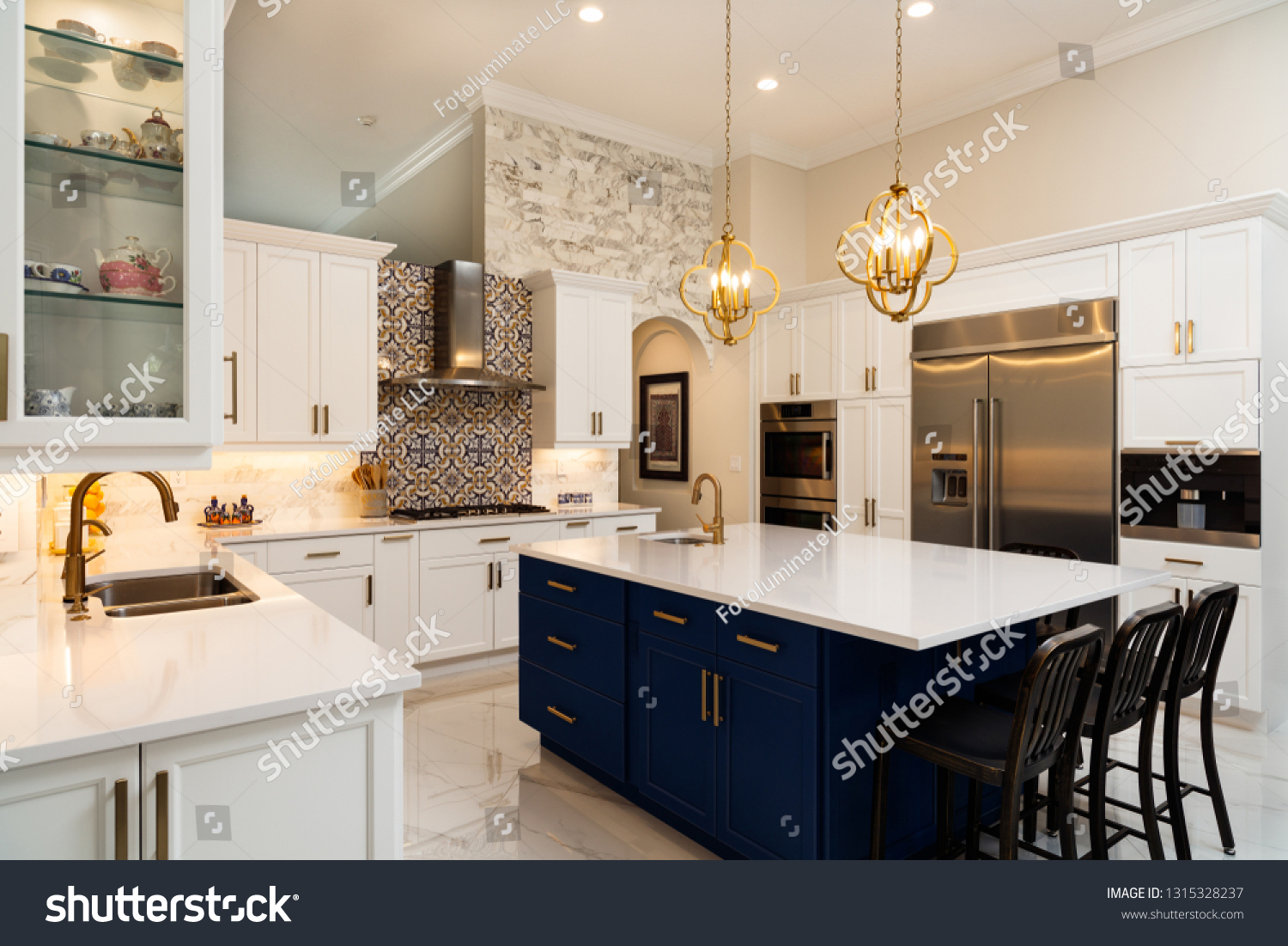 Beautiful luxury home kitchen with white cabinets. #1315328237
