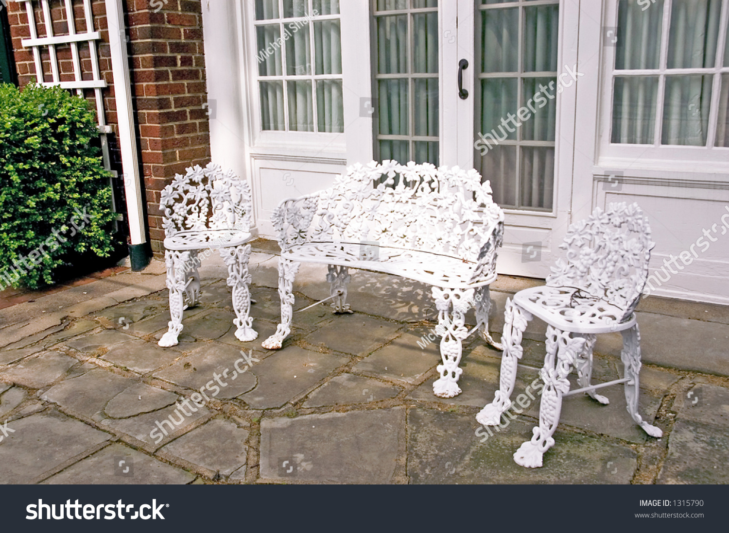 Formal Wrought Iron Patio Furniture Stock Photo 1315790