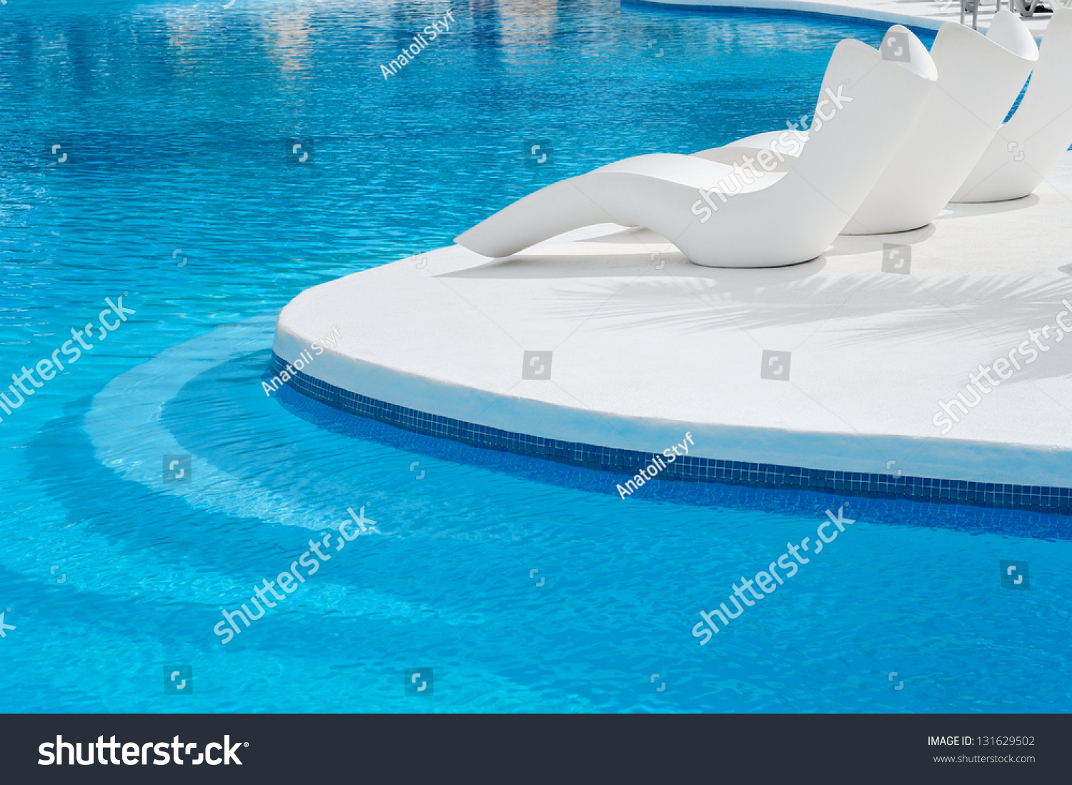 Sunbeds near swimming pool relax stock photo 131629502 - Where is my nearest swimming pool ...