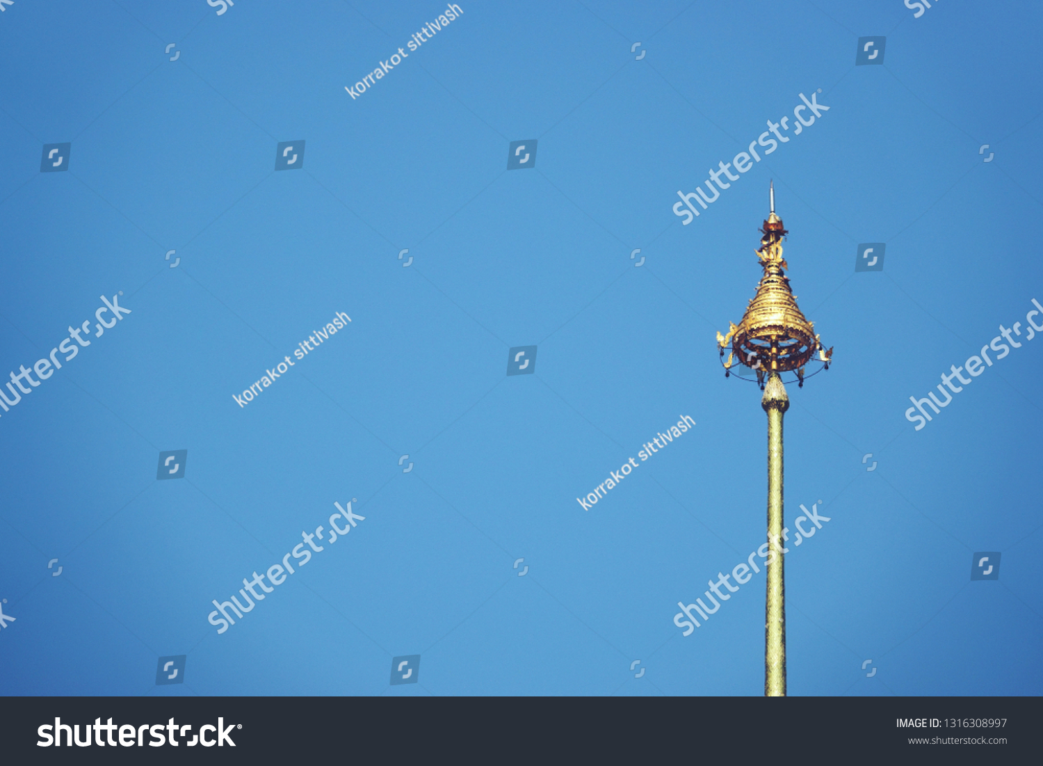 The Royal Nine-Tiered Umbrella Thailand ,Tiered umbrella with blue background, the highest point of the temple #1316308997