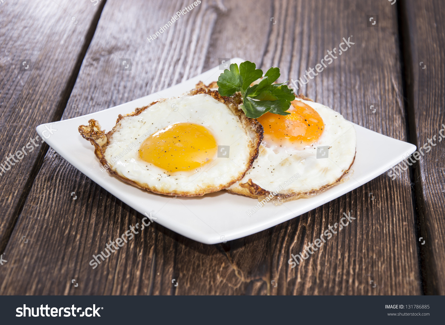 Fried eggs on plate. Putting plate with fried eggs on ...  |Fried Eggs On A Plate