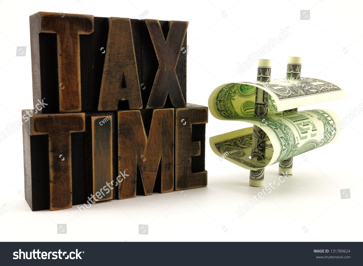 Vintage Tax Time Letters And Dollar Bills In Shape Of Money Symbol To  Represent Filing Taxes