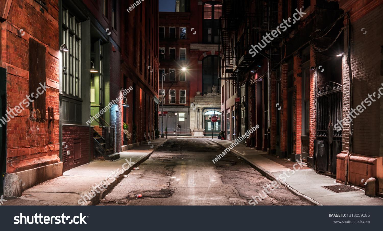 Dark street in New York at night #1318059086