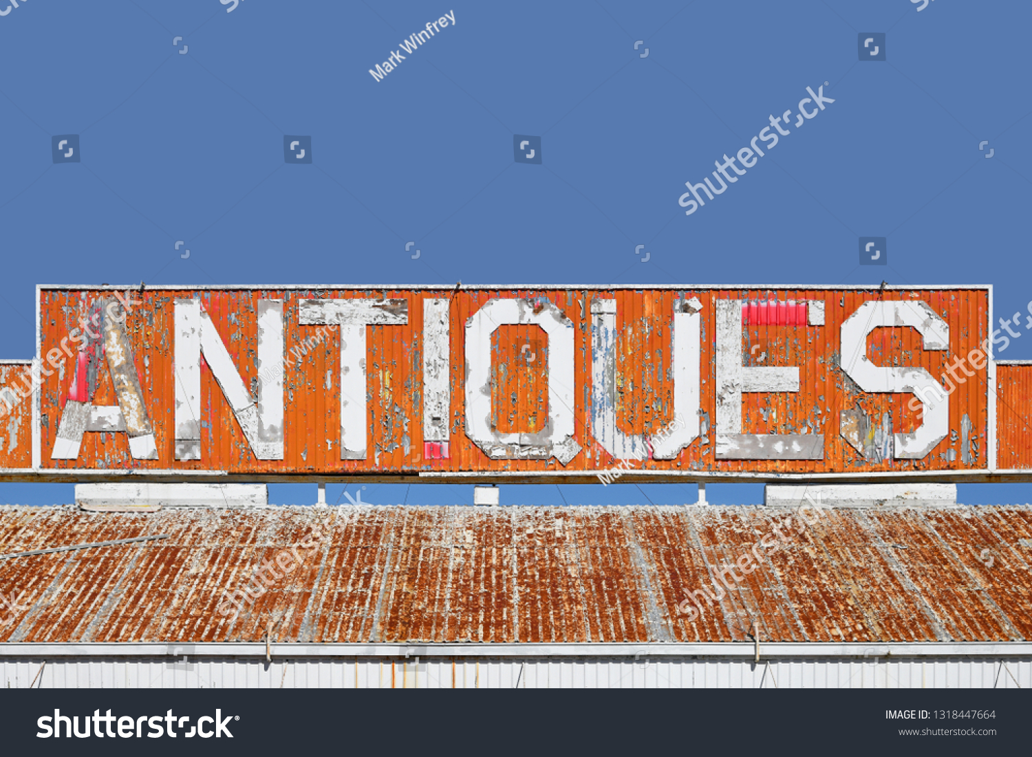 Old Antiques Sign on the Roof of a Closed Antique Store