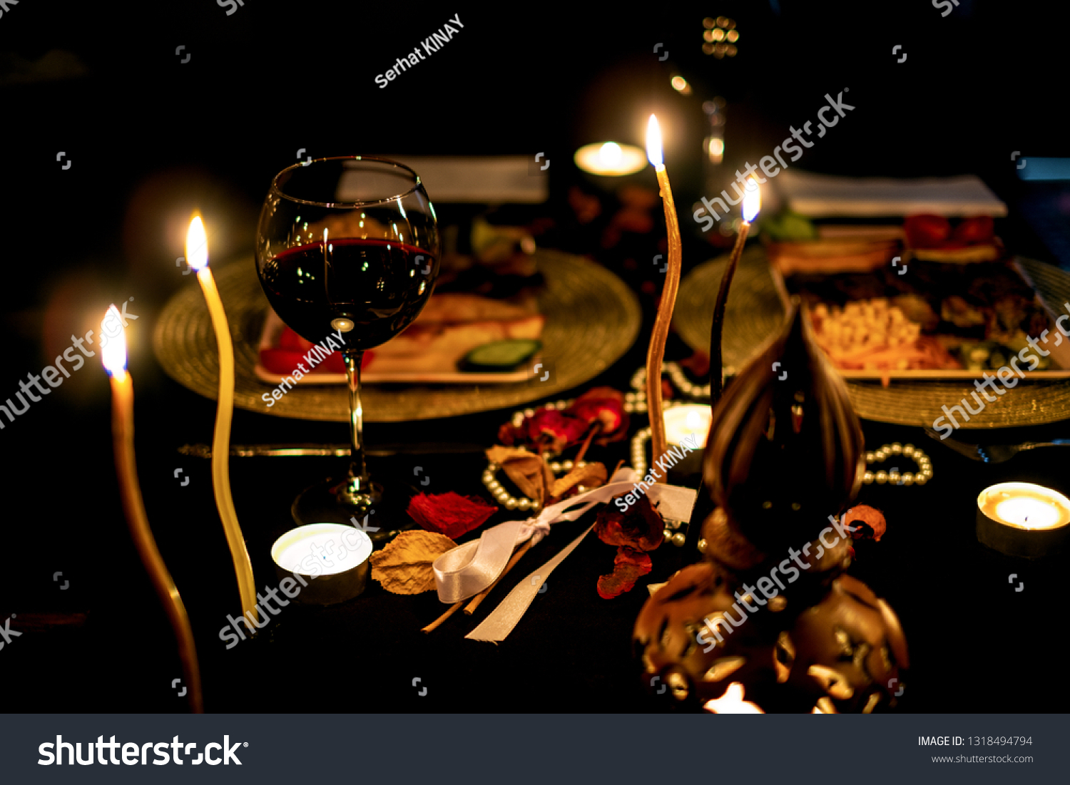 Red wine. Red wine in a glass. Dinner. Romantic dinner. Romantic dinner with red wine. #1318494794