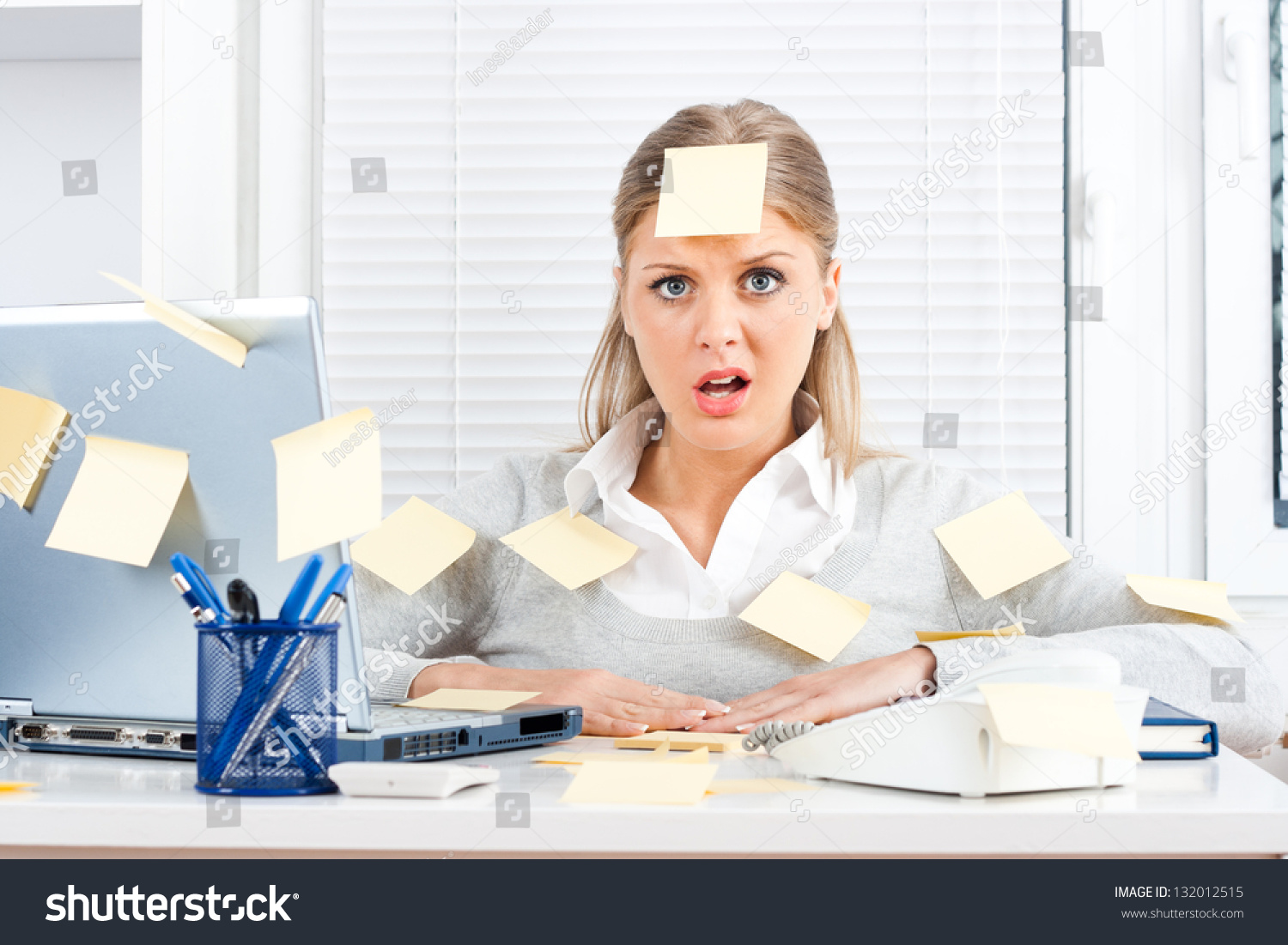young businessw much work dooverworked stock photo  young businessw too much work to do overworked