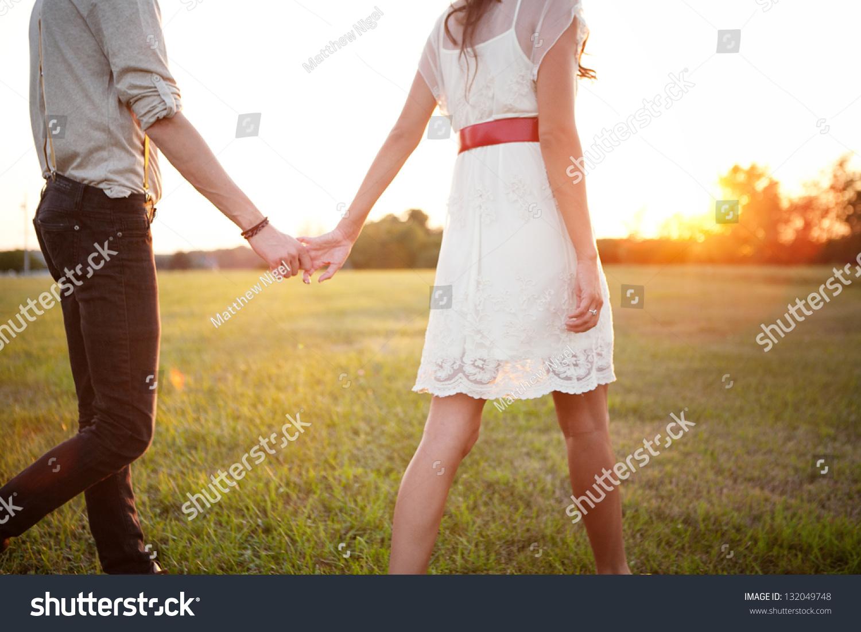 couple holding hands walking away stock photo 132049748 shutterstock. Black Bedroom Furniture Sets. Home Design Ideas