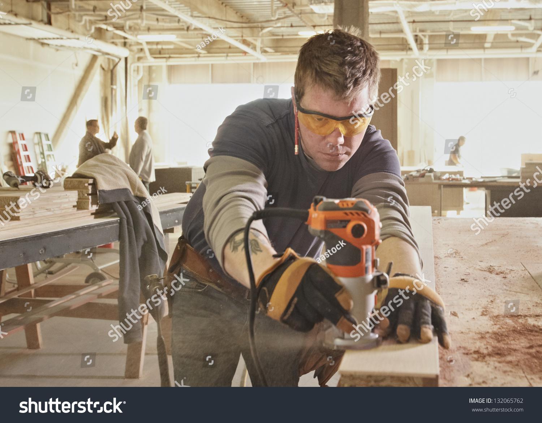 carpenter work industrial job site stock photo  carpenter at work at industrial job site
