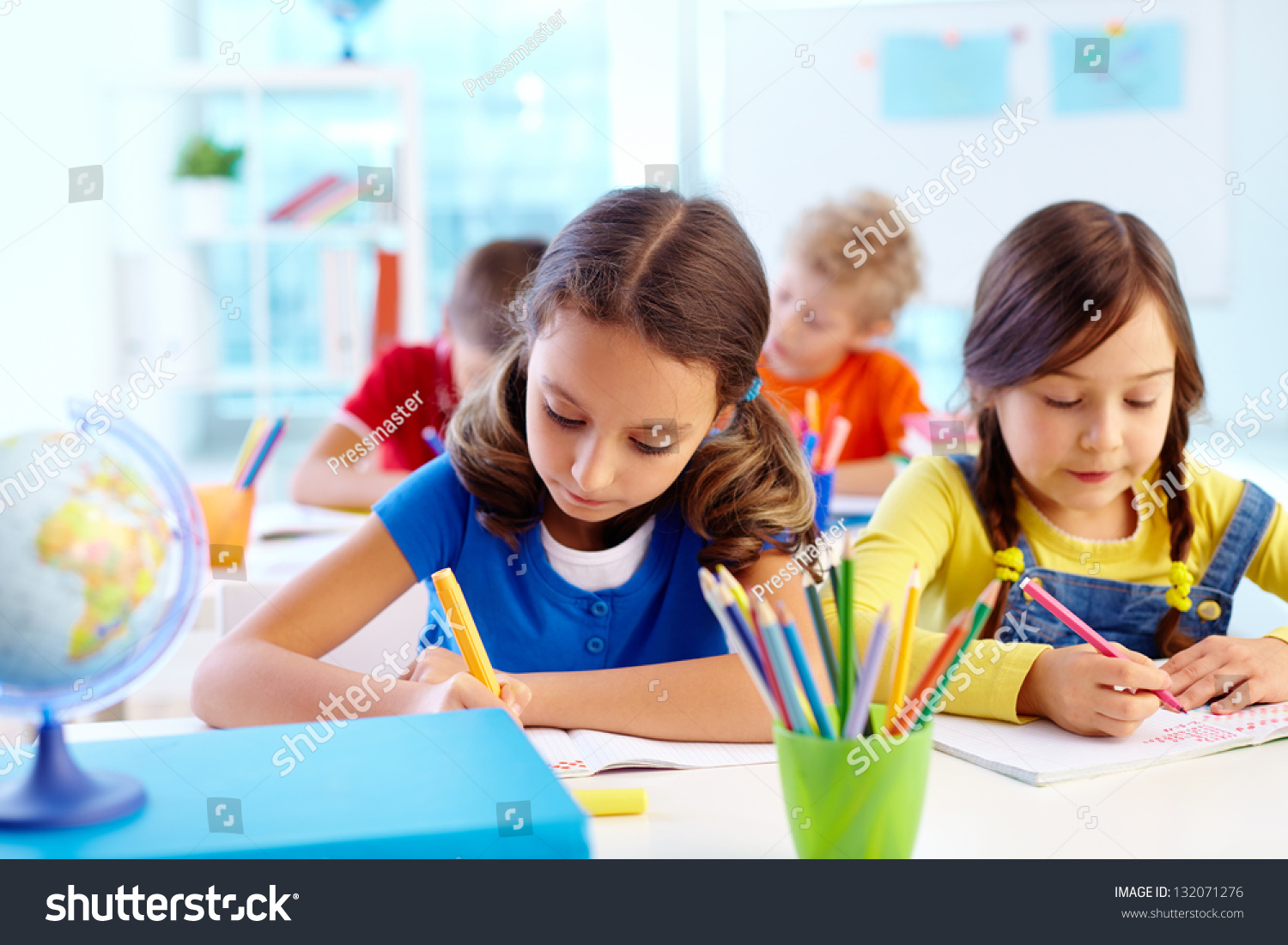 concentrated school children being occupied task stock photo edit