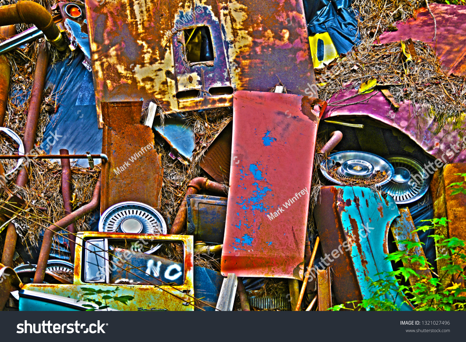 stock-photo-a-pile-of-scrap-metal-with-v