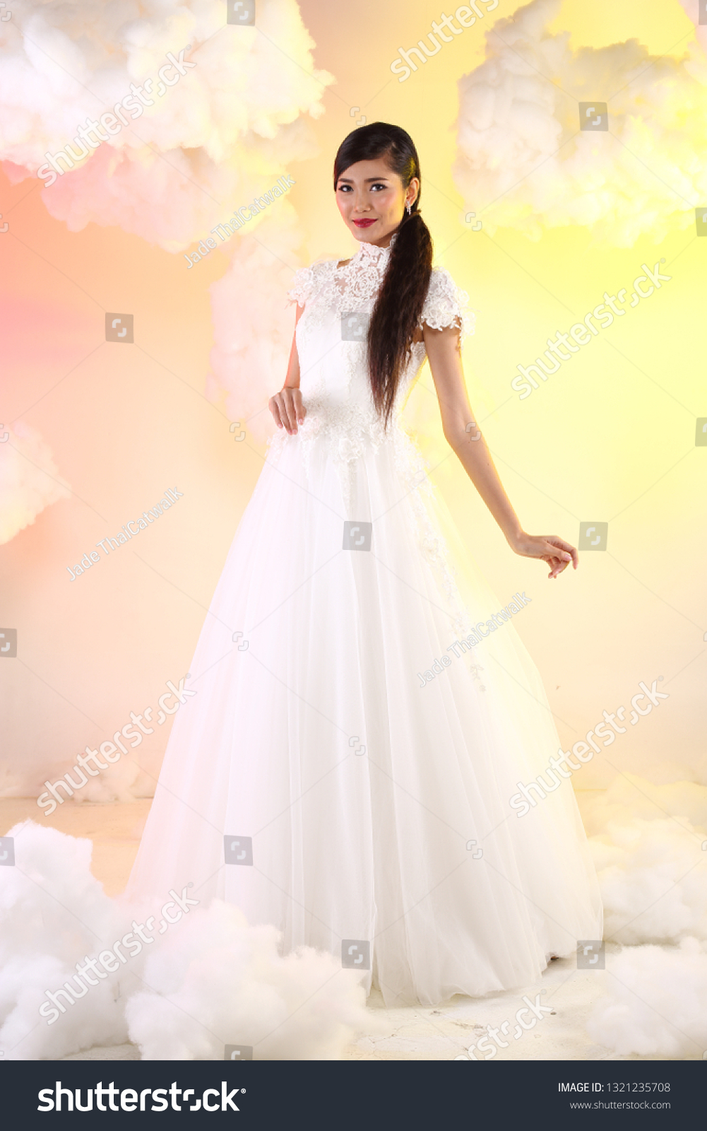 https://image.shutterstock.com/z/stock-photo-lovely-asian-beautiful-woman-bride-in-white-wedding-gown-dress-with-lace-veil-black-hair-studio-1321235708.jpg