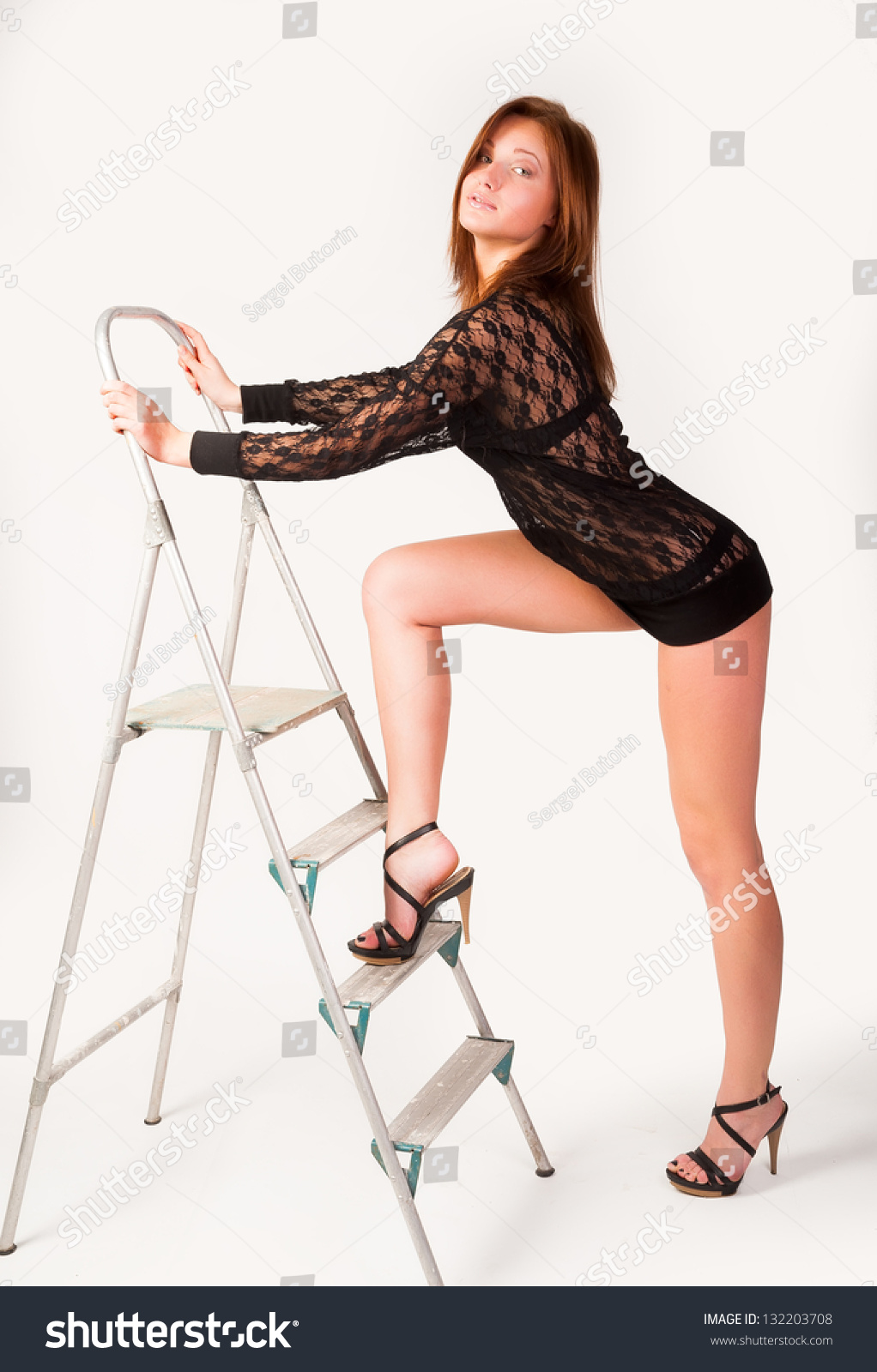 Young Attractive Woman Standing Near Ladder