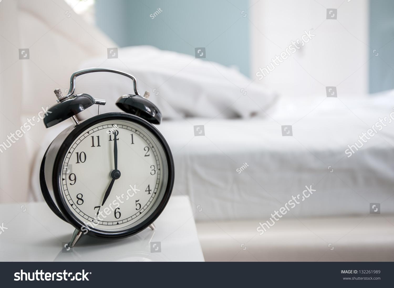 black alarm clock bed stock photo 132261989 - shutterstock