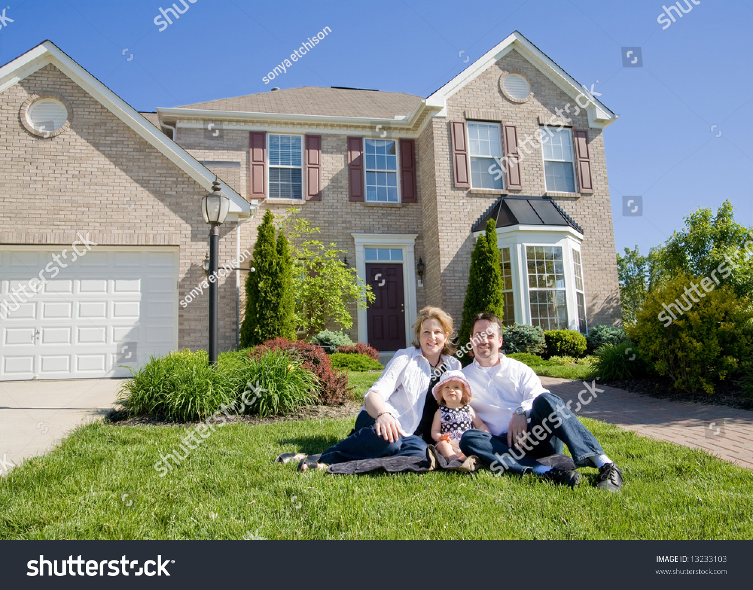 Family in front of house stock photo 13233103 shutterstock for Family in house