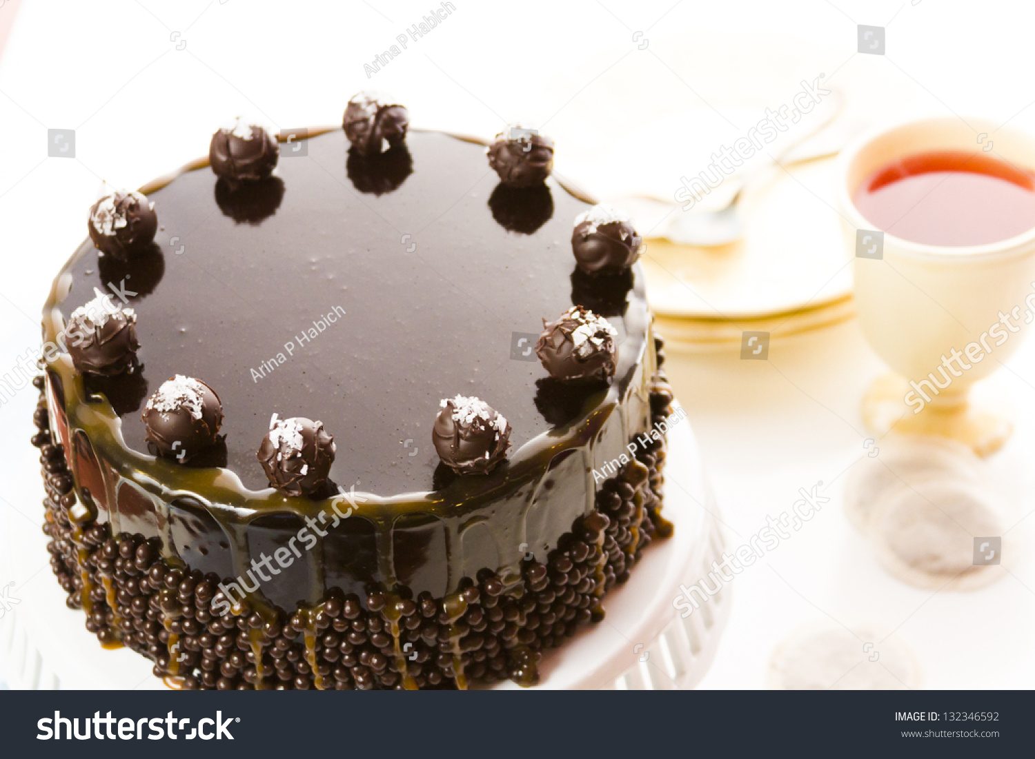 torte with layers of chocolate cake filled with salted caramel mousse ...