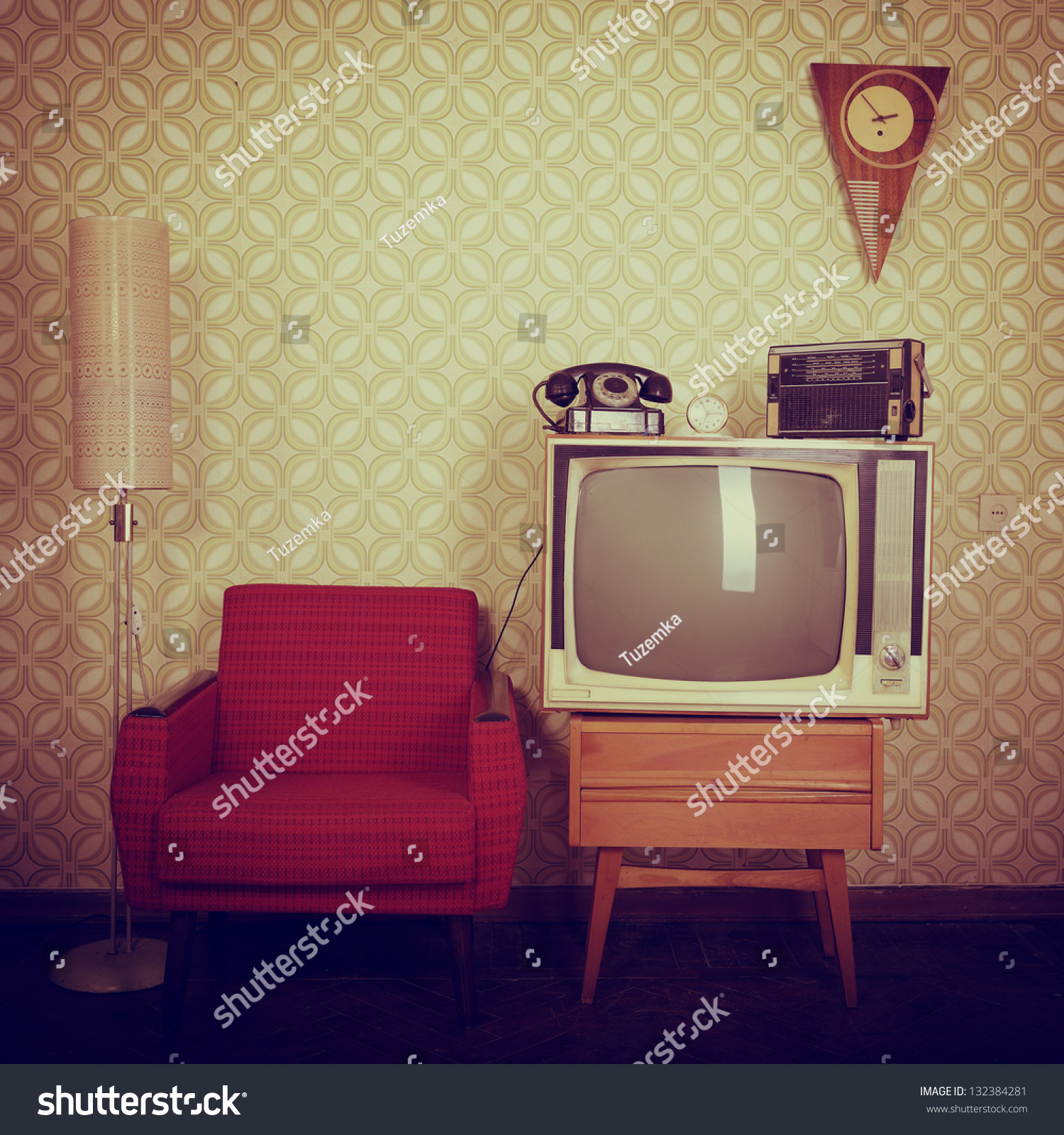 Vintage room with wallpaper, old fashioned armchair, retro tv, phone ...