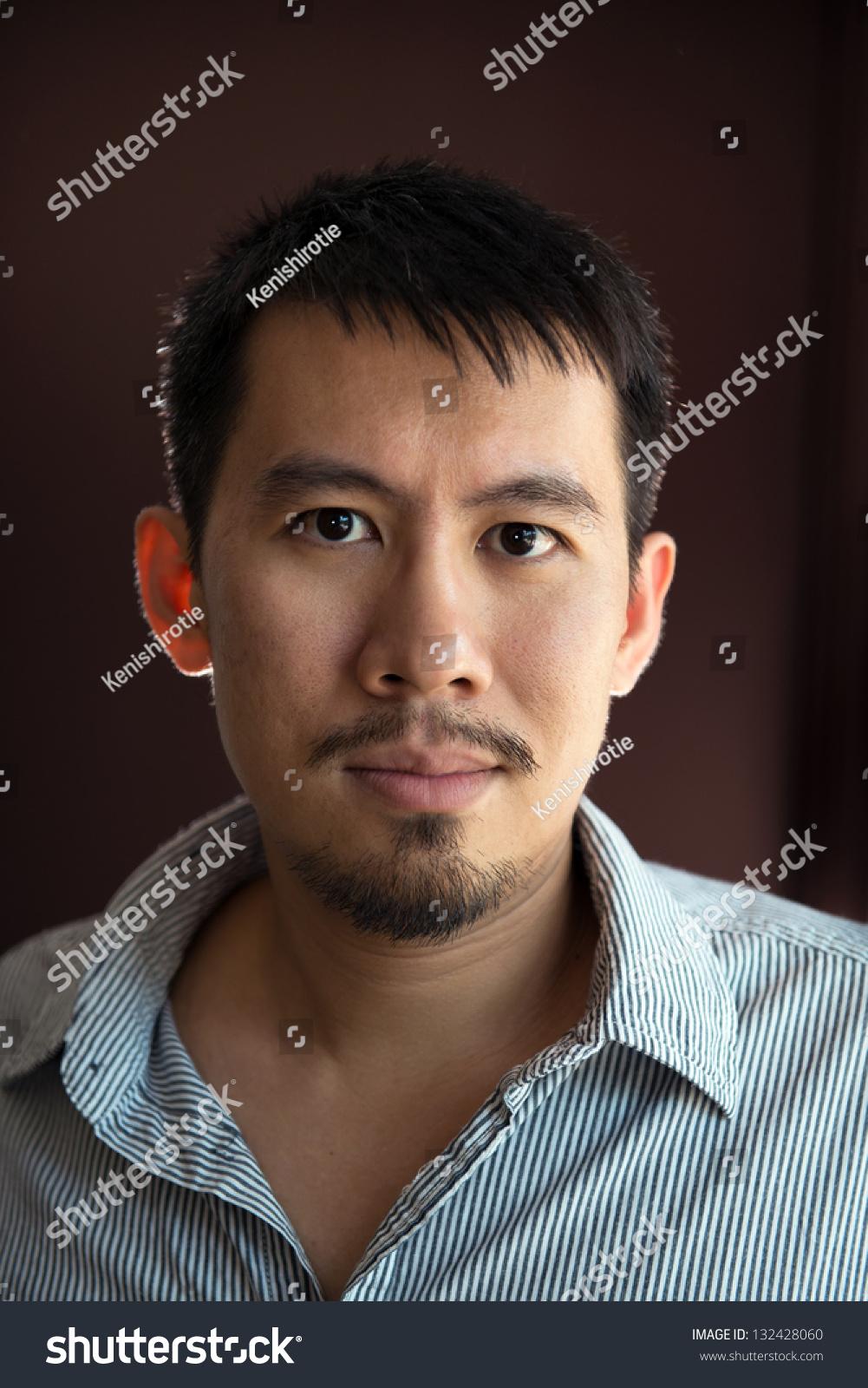 Bearded Asian Man With Tall Hair
