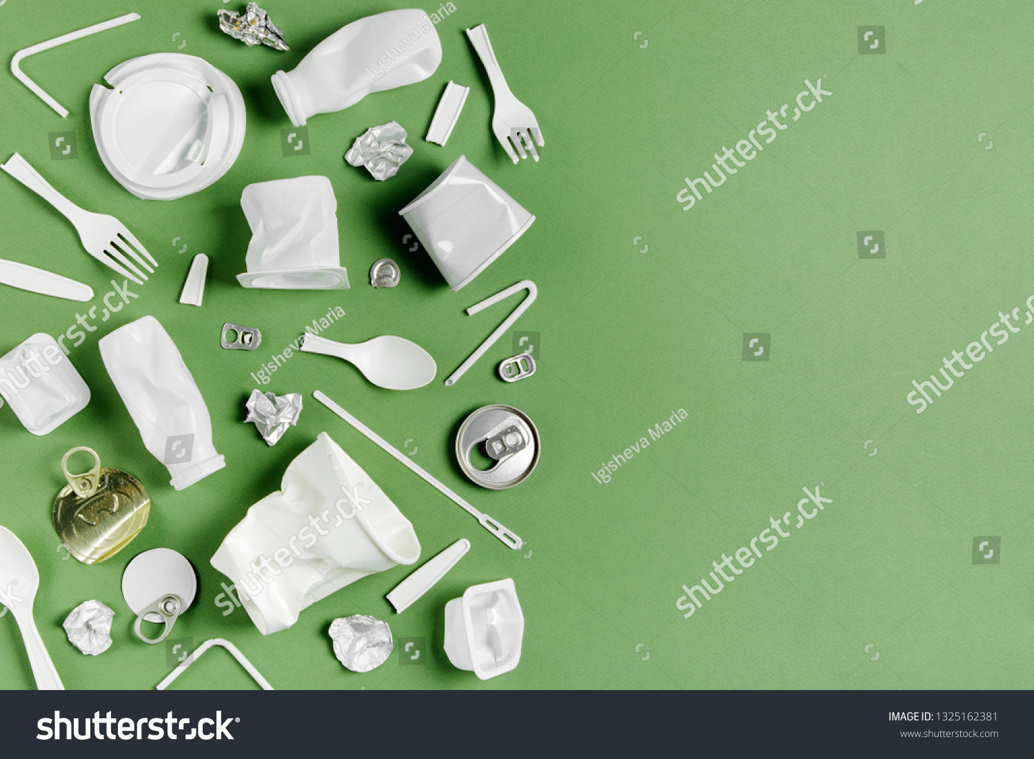 Plastic waste collection on  green background. Concept of Recycling plastic and ecology. Flat lay, top view