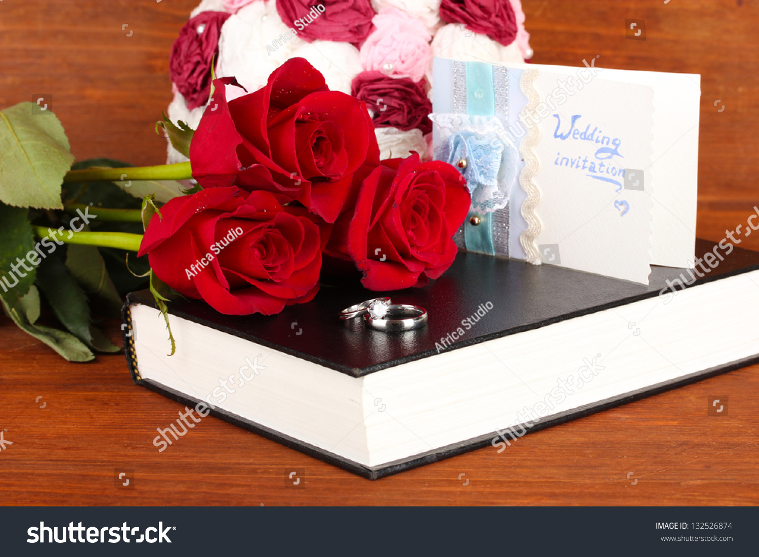 Wedding Rings Roses On Bible On Stock Photo (Edit Now) 132526874 ...