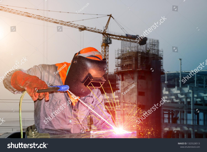 Industrial Welder Welding Steel Structure Construction Stock Photo