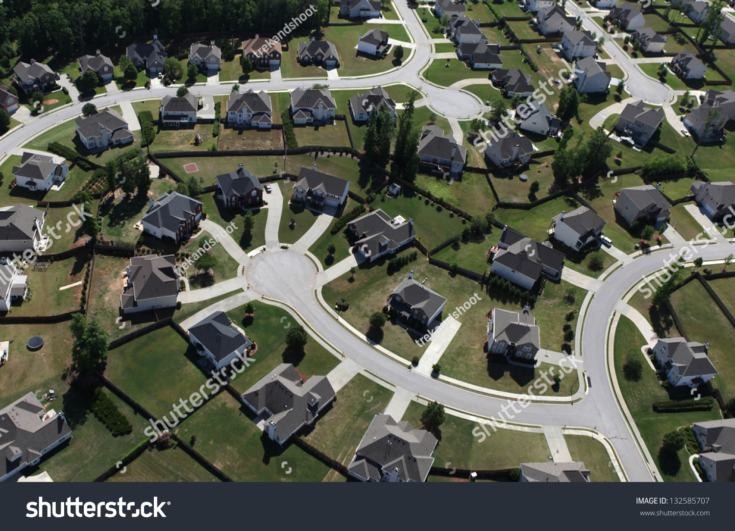http://image.shutterstock.com/z/stock-photo-aerial-of-modern-suburban-housing-in-the-eastern-united-states-132585707.jpg