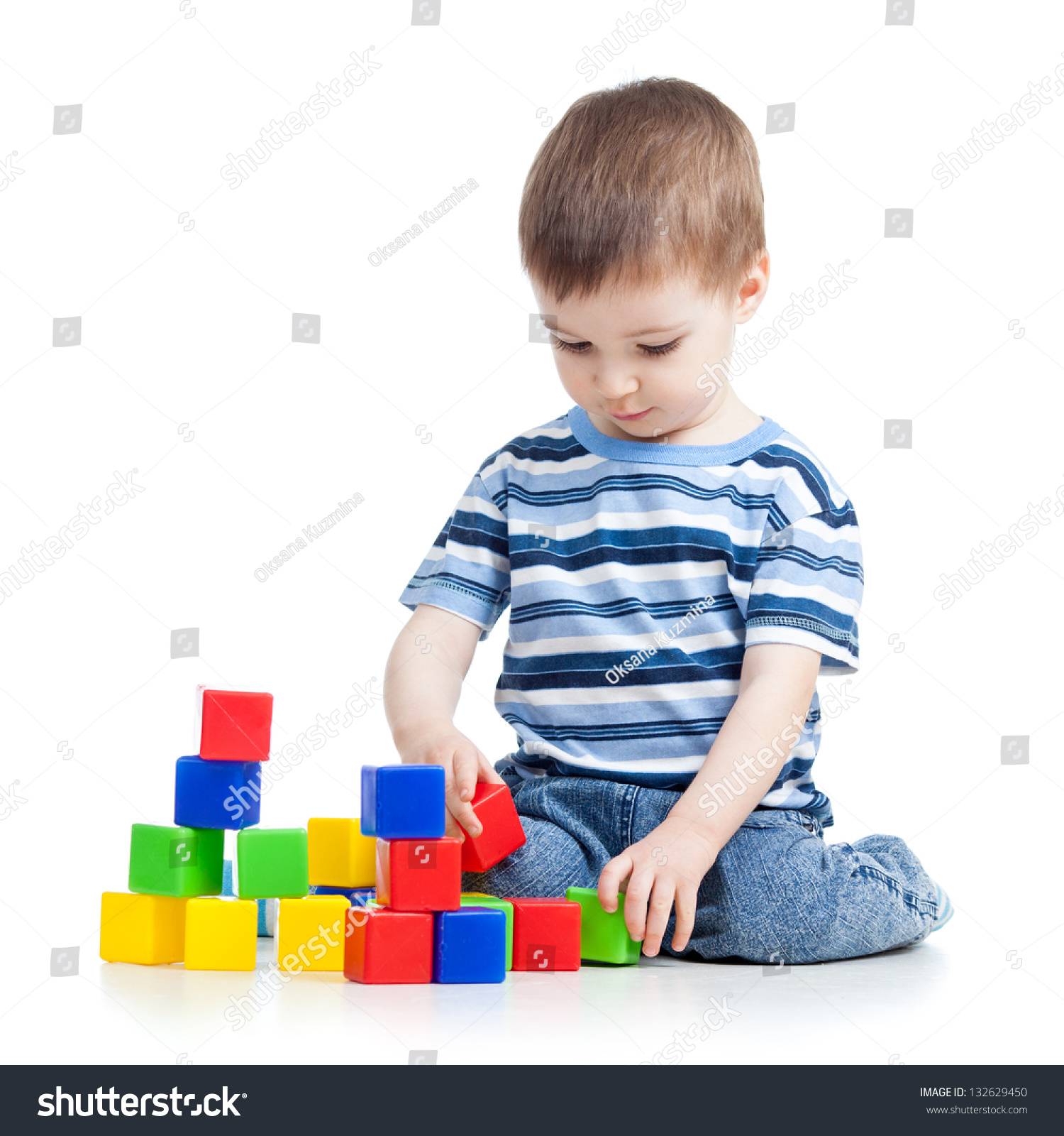 Kid Boy Playing Colorful Building Blocks Stock