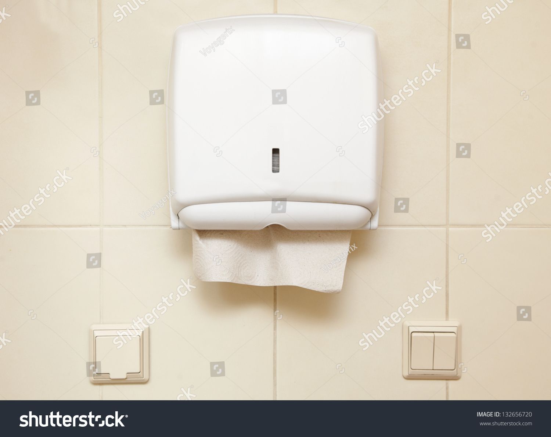 Paper Towel Dispenser On Wall Bathroom Stock Photo