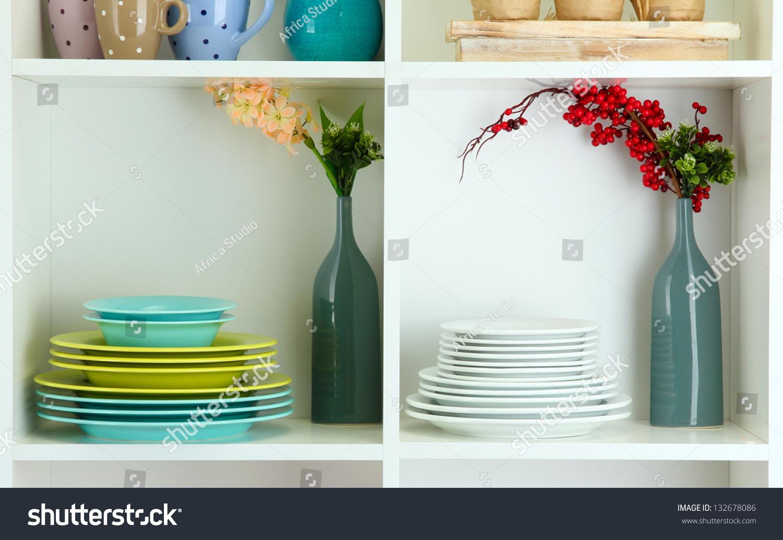Beautiful white shelves with tableware and decor stock photo 132678086 shutterstock - Beautiful photoshelves ...