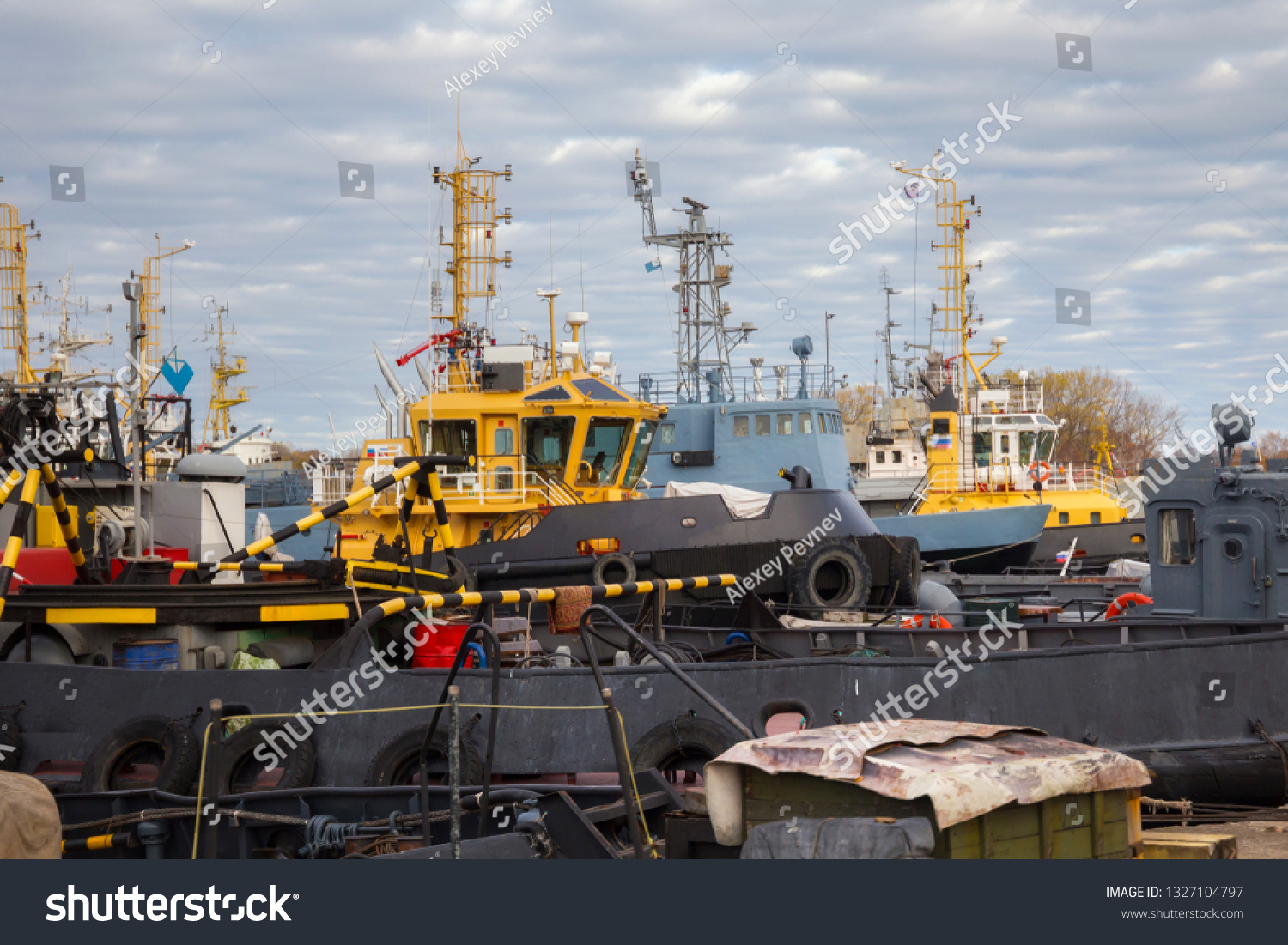 Tugboats and other marine support vessels in port. #1327104797