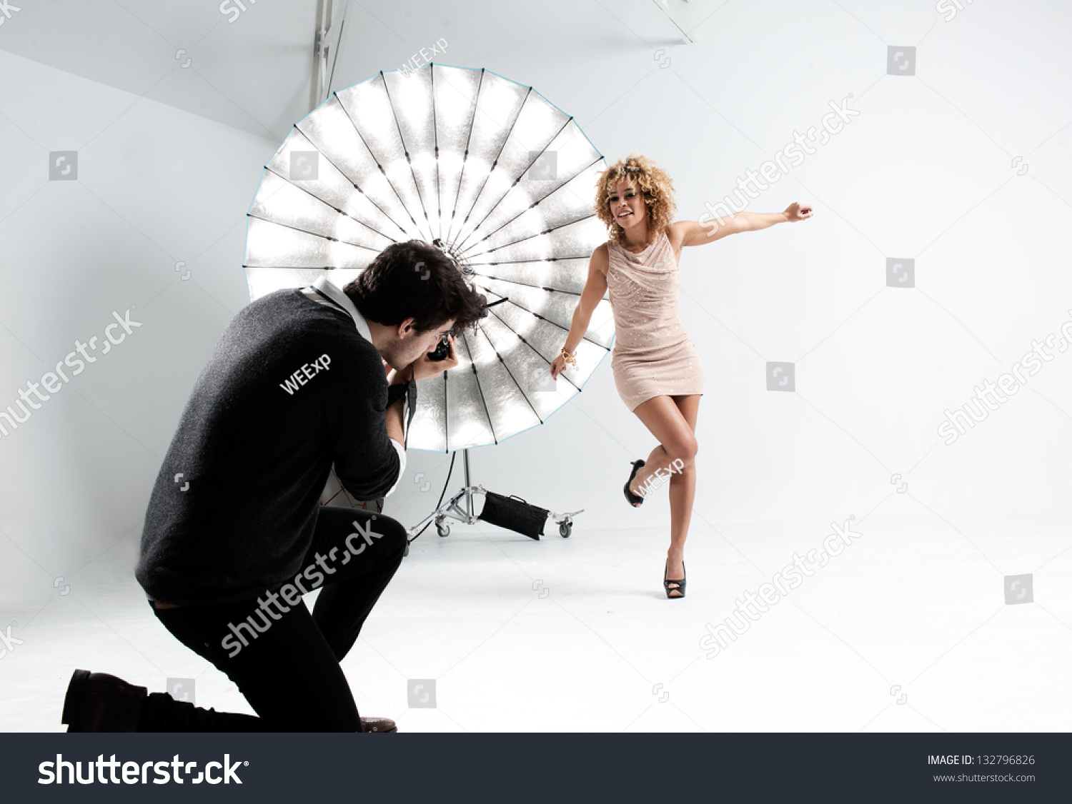 http://image.shutterstock.com/z/stock-photo-photographer-working-with-a-cute-model-in-a-professional-studio-132796826.jpg