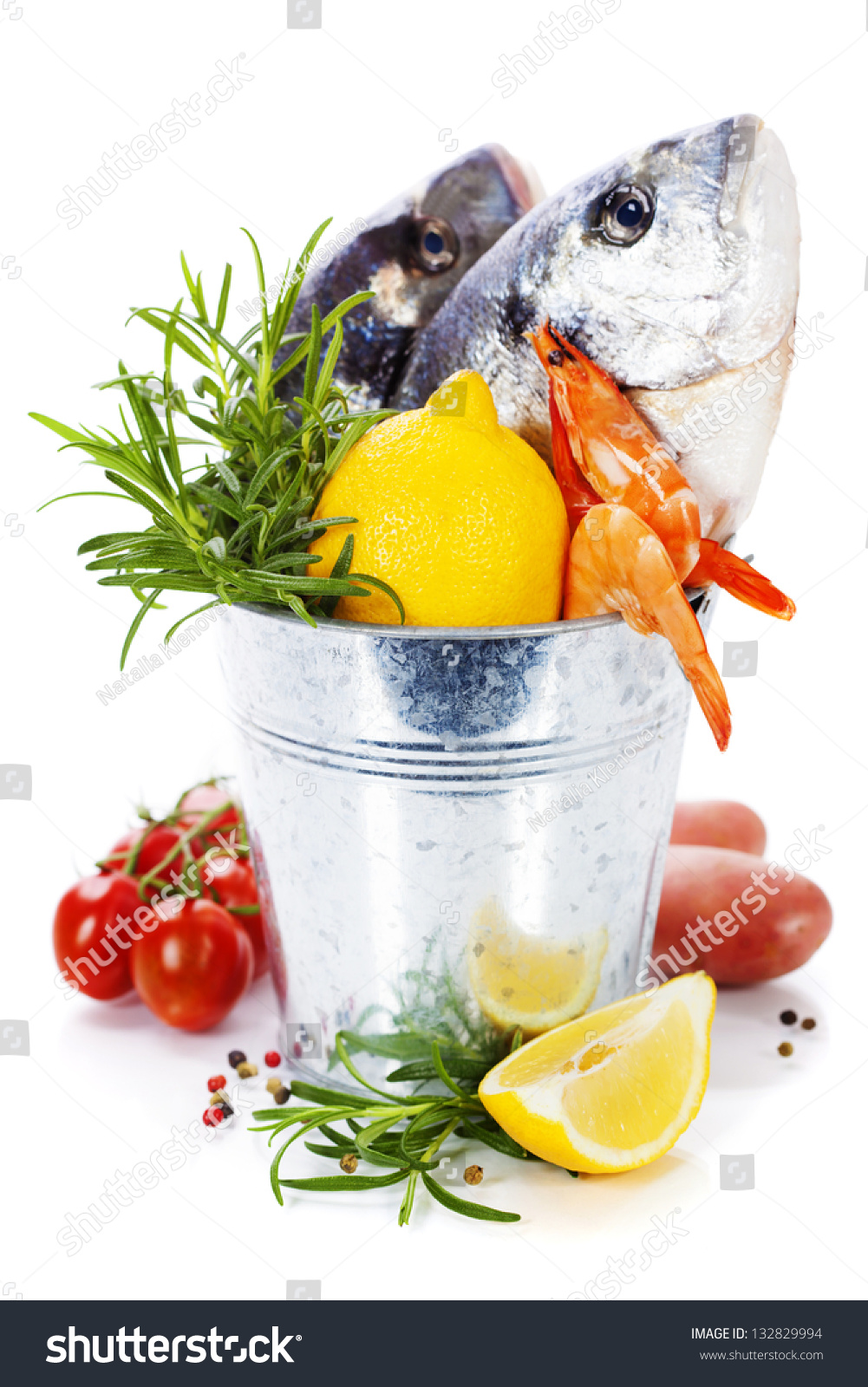 Fresh dorada fish with vegetables over white stock photo for Fish with vegetables