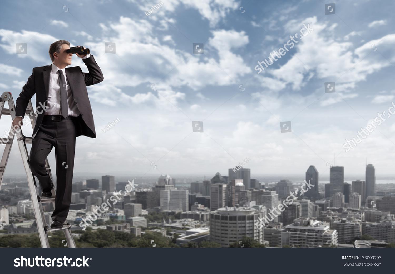 Businessman Binoculars Spying On Competitors Stock Photo