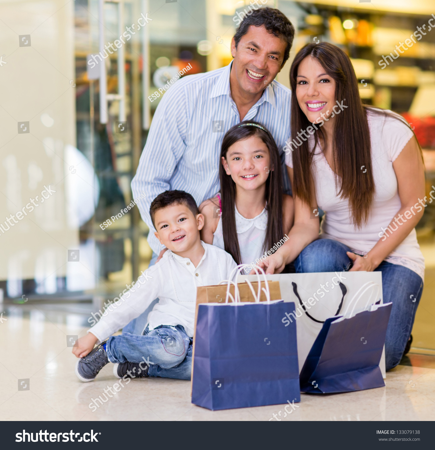 Beautiful Family Shopping At The Mall And Looking Very Happy