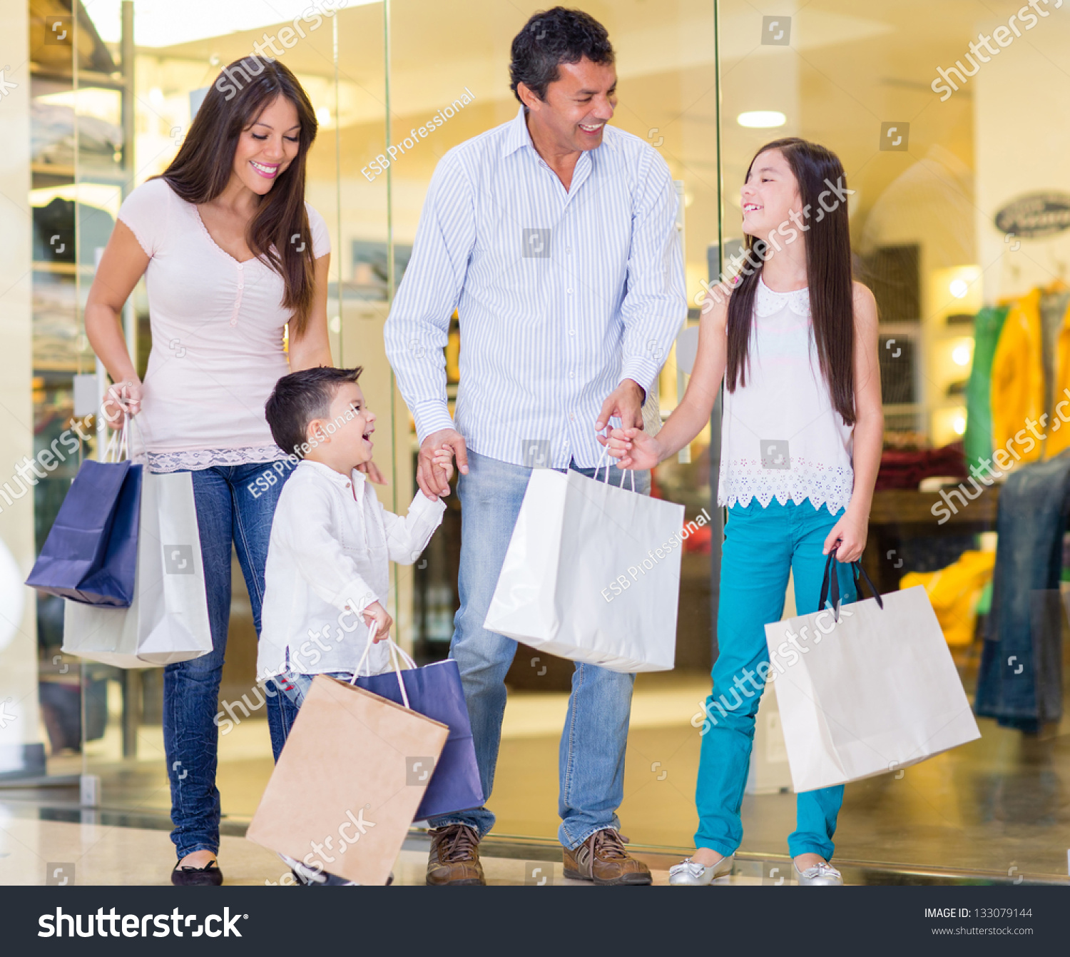 Family Shopping At The Mall And Looking Very Happy