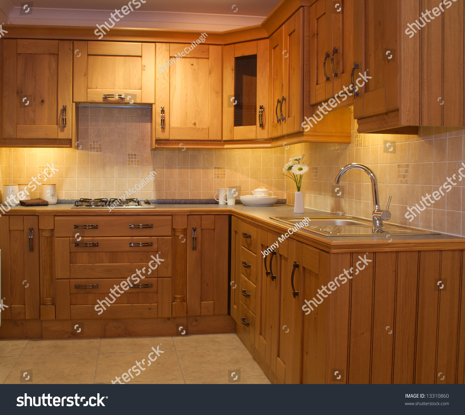Warm Modern Contemporary Kitchen Design Worktop And Cupboards In Showroom Stock Photo 13310860