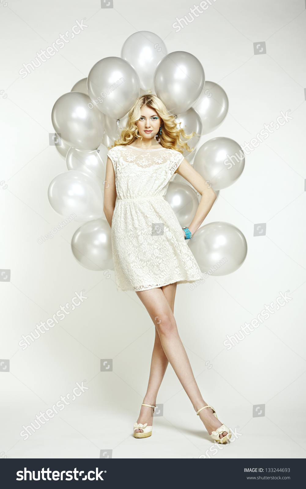 Fashion photo of beautiful woman with balloons girl posing studio photo