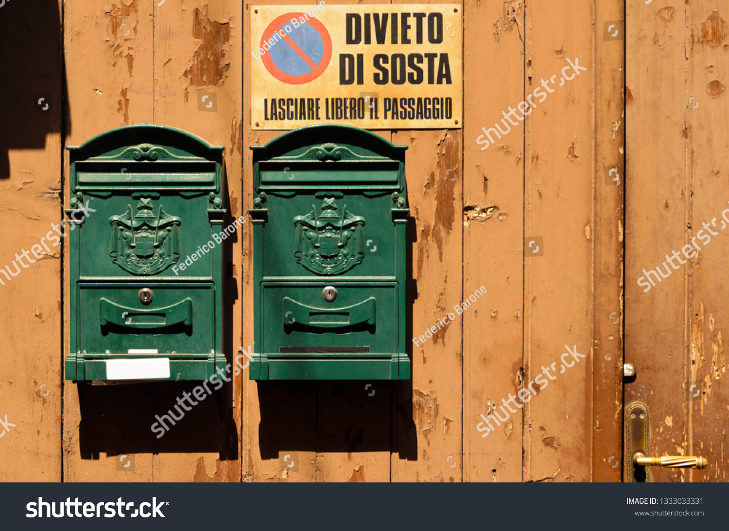 stock-photo-two-green-mailboxes-on-a-woo