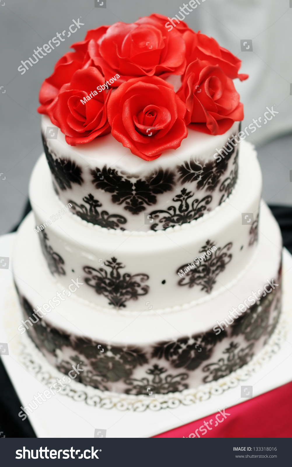 Delicious Black And White Wedding Cake Decorated With Sugar Red Roses