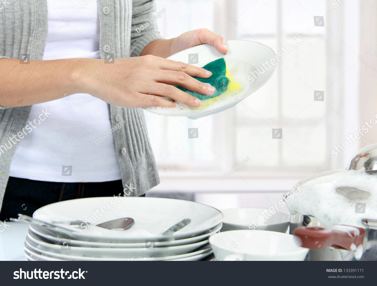 Woman Washing Dishes B...
