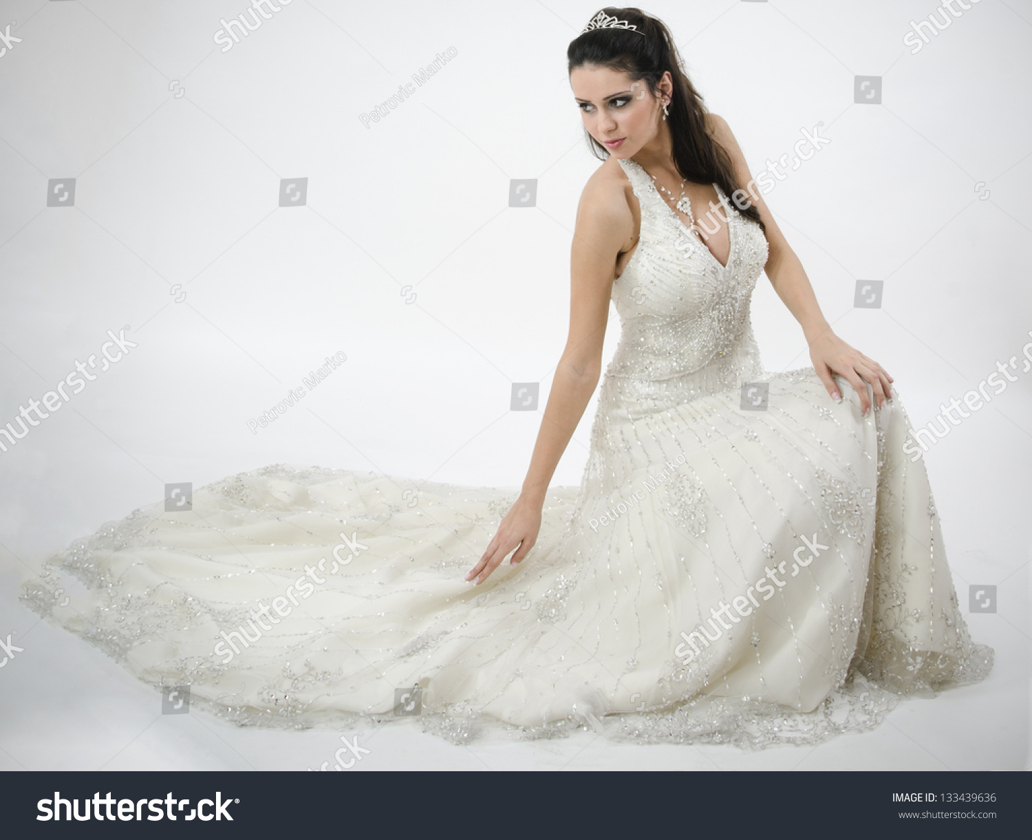 Beautiful Bride In Wedding Dress Sitting Looking Down And Touches The: Haute Couture Wedding Dress Sitting At Reisefeber.org