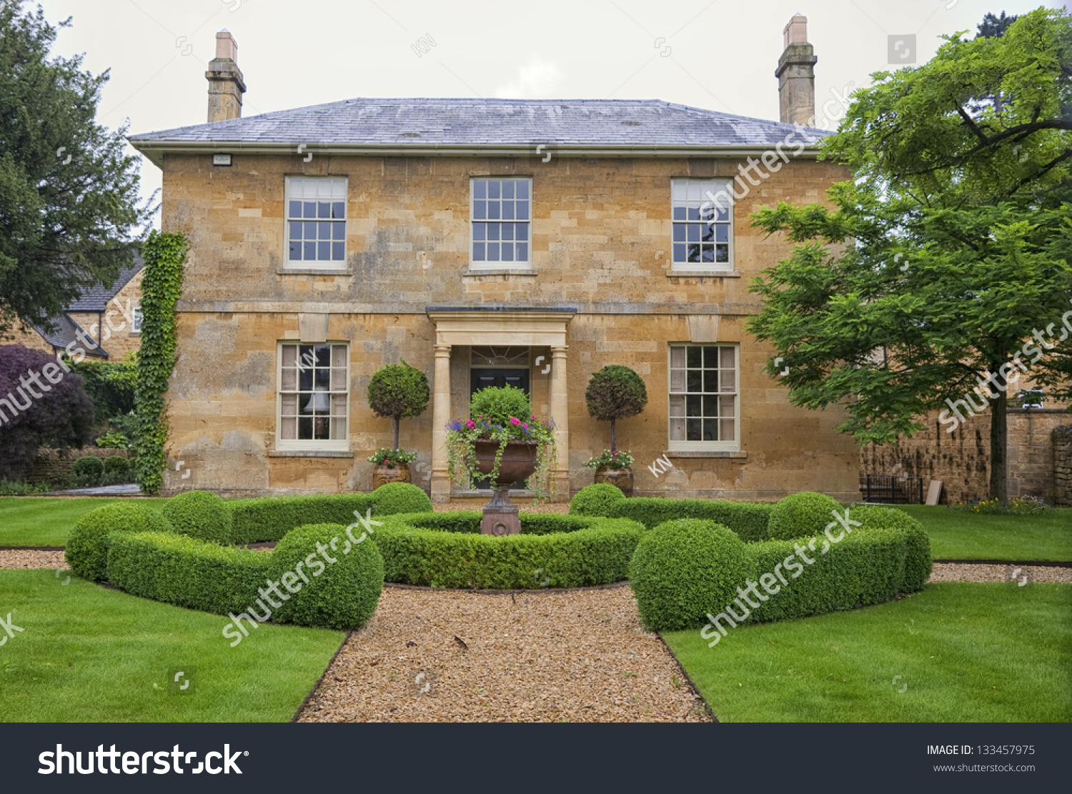 Traditional English Village House Beautiful Garden Stock