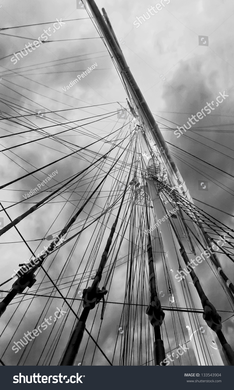 Gear old sailing ship on the background of an overcast sky - Turku, Finland (black and white) #133543904