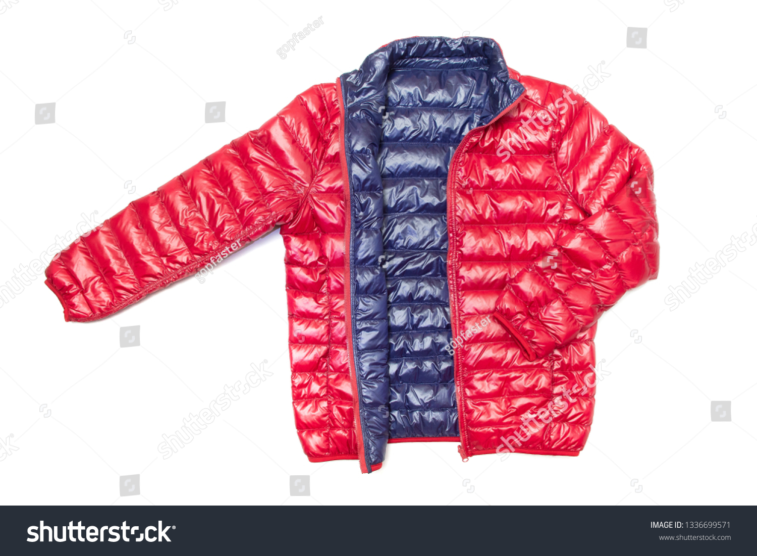 ฺBlue and red full zipper windbreaker down jacket, rain proof down jacket. Down jacket sport shiny nylon full zip isolated on white.  #1336699571