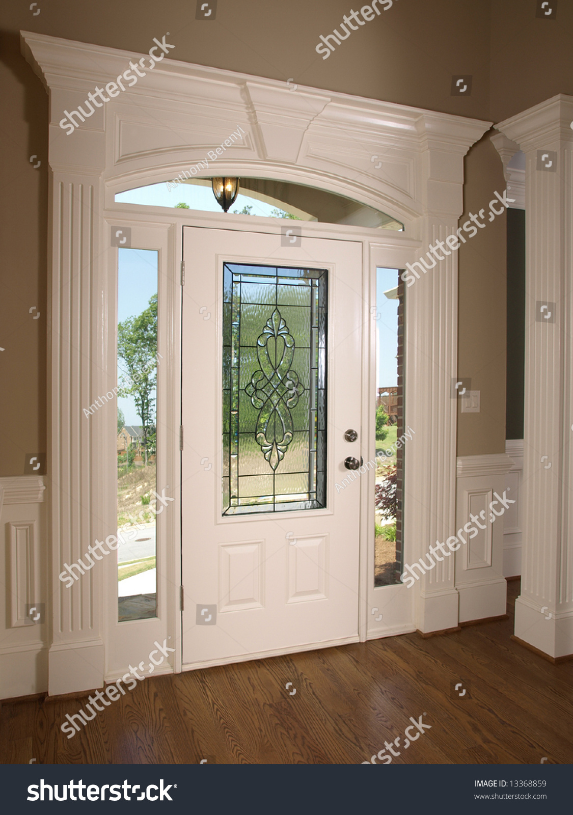 Luxury Glass Door : Luxury model home stained glass front stock photo